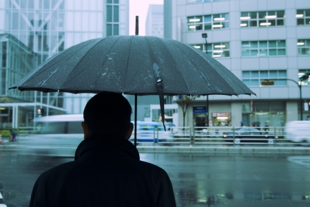 bad condition: Tokyo rainy background, focus on man and umbrella