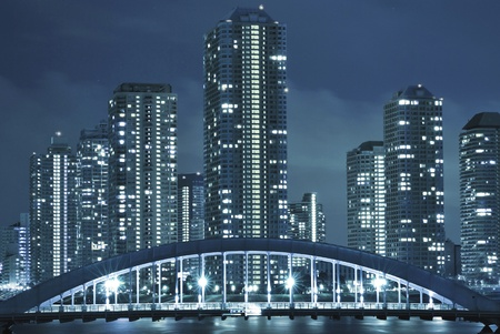 cold toned cityscape of night Tokyo, modern buildings at Tsukishima district and Eitai bridge