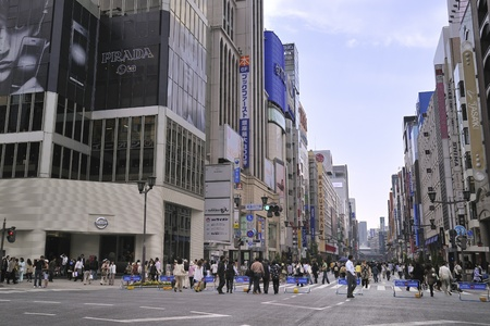 Tokyo, Japan - May 17, 2008 : people crowds move freely along Ginza street of Tokyo metropolis. Ginza is main shopping street of Tokyo and it is closed for cars traffic on Sundays.