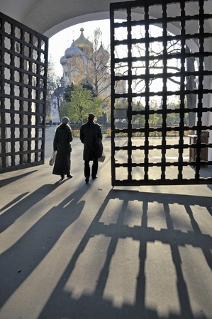 people on the entrance gate of famous Novodevichy Convent in Moscow photo