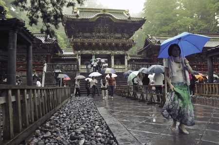 rain japan: Nikko, Tochigi, Japan - June 22, 2008: Visitors walks under rain on the place of famous Toshogu shrine. The Toshogu is famous as a mausoleum of Tokugawa Ieyasu, founder of the Tokugawa shogunate, which ruled Japan for over 250 years until 1868.