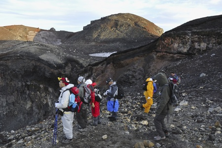 Mt.Fuji peak, Yamanashi, Japan - July 13, 2008: Hikers stay close to the edge of mt.Fuji crater by early morning. Mt. Fuiji is sleeping volcano and very popular tourist destination by summer time.