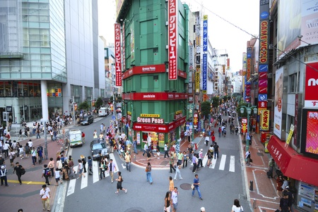 Tokyo, Japan - September 01,  2007: Pedestrians walking on scenic streets close to JR station in famous Shinjuku area in Tokyo, Japan Stock Photo - 11971033
