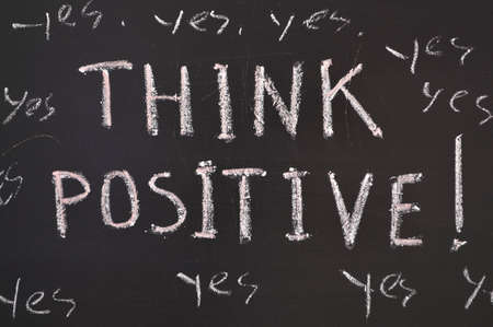 think positive concept handwritten on black chalkboard Stock Photo - 12465564