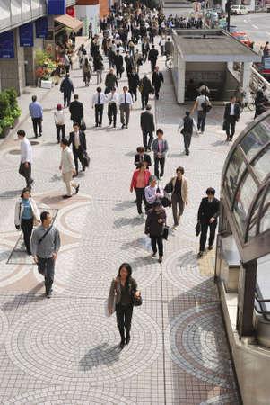 Tokyo, Japan - April 24, 2008: many people walk near Shinjuku railway terminal by day time.