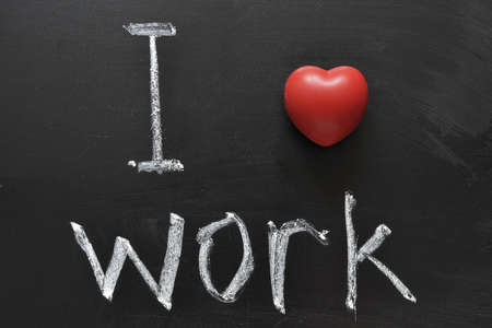 I love work -  positive concept handwritten on black chalkboard Stock Photo - 12783681