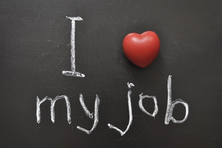 aspirational: I love my job -  positive concept handwritten on black chalkboard with volume red heart symbol