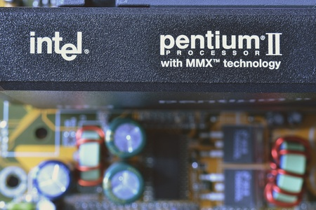 Minsk, Belarus - April 7, 2012 : closeup of famous Intel Pentium II processor set on vintage PC motherboard. This processor was introduced in 1997 and was available in speeds from 233 MHz up to 450 MHz. Stock Photo - 13073394