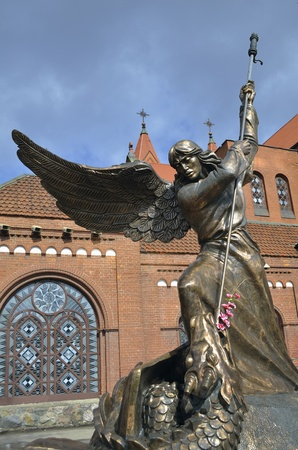 statue of St Michael near  Catholic chapel St Simon and St Helena also called as Red Church in Minsk photo