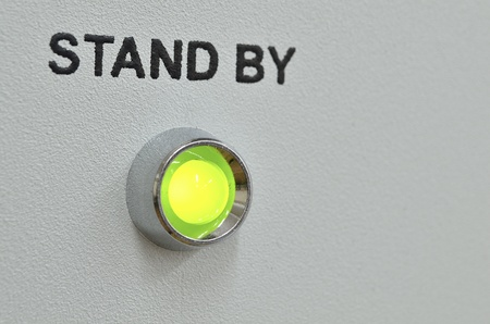 green LED lightning with stand by text over it on the gray panel of the device; focus on green LED Stock Photo - 13297505