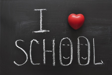 handwritten I love school phrase on the black chalkboard with red heart symbol photo