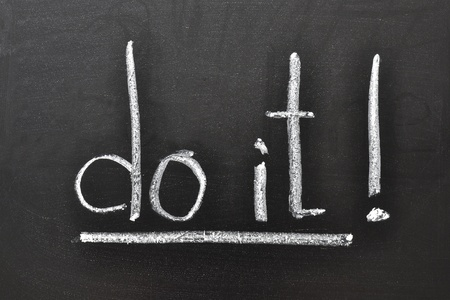 handwritten motivation words - Do it! on the school blackboard Stock Photo - 13486076