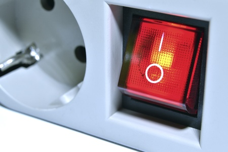 closeup of electrical line with power switch button; focus on button Stock Photo - 13486078