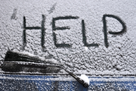 Help word written on rear car window covered by heavy snowfall