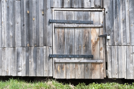 old barn wall with locked wooden door photo
