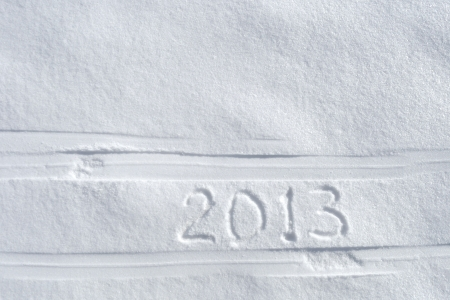 2013 text written between ski tracks photo