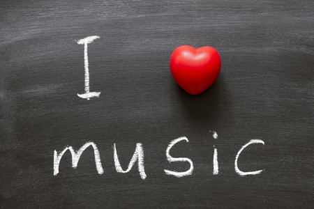 I love music phrase handwritten on the school blackboard Stock Photo - 14884101