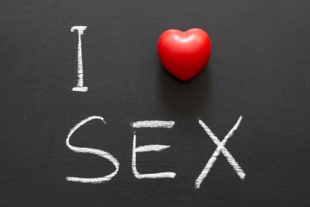 adult sex: I love SEX handwritten on blackboard Stock Photo