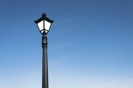 vintage street lamp over blue sky photo