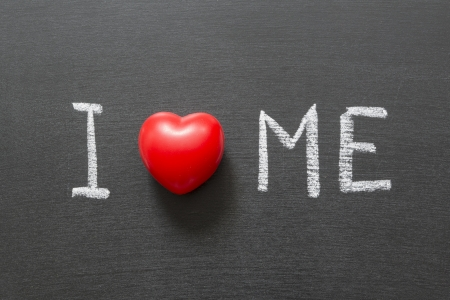 I love me phrase handwritten on the school blackboard Stock Photo