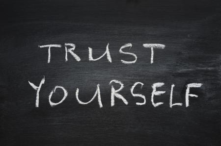 trust yourself phrase handwritten on school blackboard