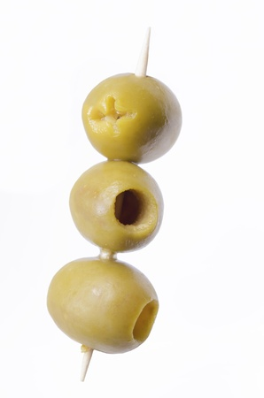 pitted: three pitted green olives on wooden stick