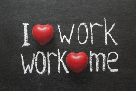I love work, work loves mephrase handwritten on blackboard Stock Photo