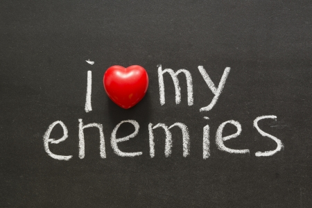 I love my enemies phrase handwritten on blackboard  photo