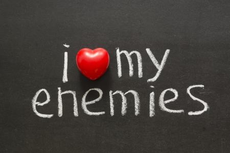 declaration of love: I love my enemies phrase handwritten on blackboard