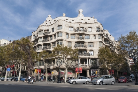 Barcelona, Spain - November 14, 2009 : sunny day view to the famous La Pedrera (CASA MILA) building located at Passeig de Gràcia 92. This building is creation of modernist architect Antonio Gaudi constructed between 1906 and 1912.