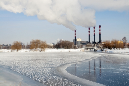 industrial cityscape with frozen river and power plant chimneys on backward in Minsk, Belarus Stock Photo - 15795692