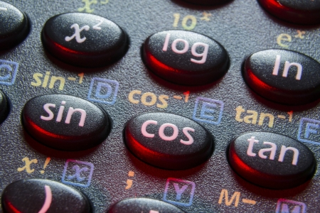 trigonometry functions push buttons of scientific calculator; focus on cos button Stock Photo - 15795757
