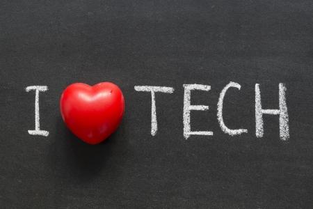 phrase novel: I love tech phrase handwritten on the school blackboard