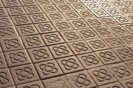 the pavement: scenic Barcelona city pavement tiles in light of evening sun