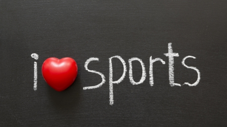 i like my school: I love sports phrase handwritten on the school blackboard Stock Photo