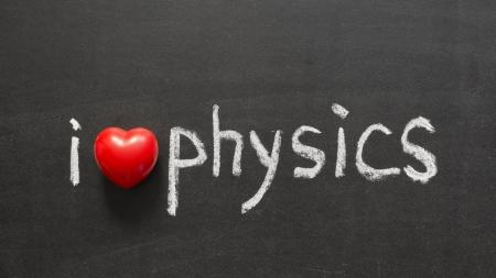 phrase novel: I love physics phrase handwritten on the school blackboard Stock Photo