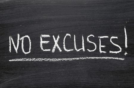 no excuses phrase handwritten on blackboard Фото со стока