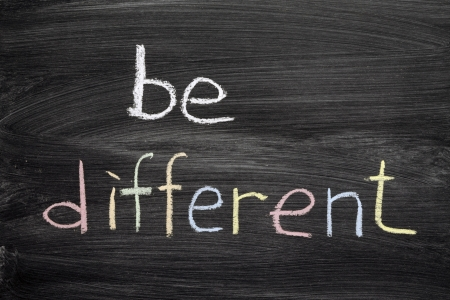 be different phrase handwritten on school blackboard photo