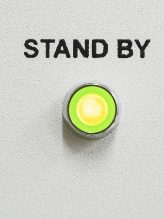 green LED lightning with stand by text over it on the gray panel of the device; Stock Photo - 16645666