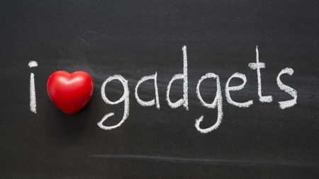 phrase: I Love gadgets phrase handwritten on blackboard Stock Photo