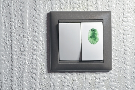 two keys light switch, one is touched by green color fingertip to switch  green  ecological energy Stock Photo - 16909334