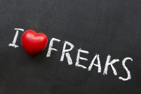 freaks: I love freaks phrase handwritten on blackboard Stock Photo