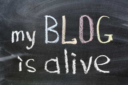 my blog is alive phrase handwritten on school blackboard photo