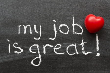 job occupation: my job is great -  positive concept phrase handwritten on black chalkboard with volume red heart symbol