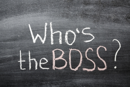 who is the Boss question handwritten on the school blackboard photo