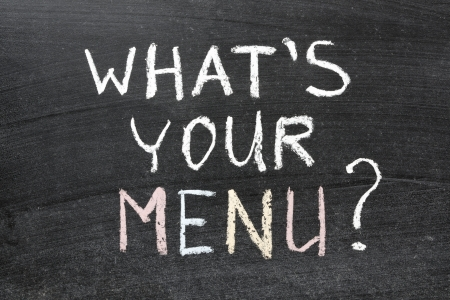 food questions: whats your menu question handwritten on the school blackboard Stock Photo