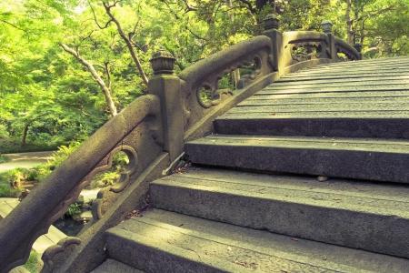 handrails: stone humpbacked bridge fragment with carved handrails in Japanese zen garden
