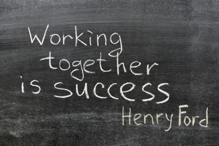 final phrase of famous Henry Ford quote  Coming together is a beginning  Keeping together is progress  Working together is success   handwritten on blackboard photo