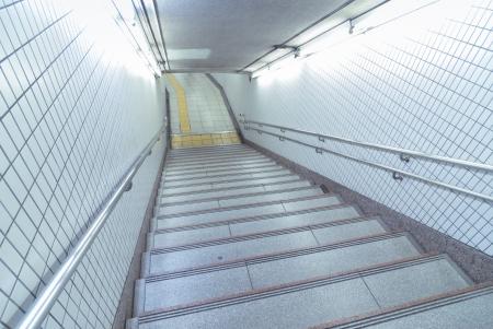 metallic stairs: well illuminated underground stairs with metallic handrails