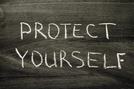 phrase: protect yourself phrase handwritten on school blackboard